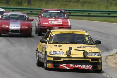 No-0317 The SCCA NC Region Charge of the Headlight Brigade at VIR on June 14-15 2003