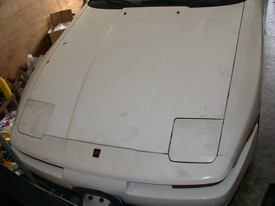 the hood is notably cleaner than the rest of the car, due to its time away from said car