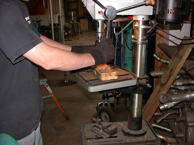drilling out the studholes on the flange