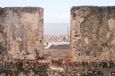 Crowded graveyard beside the fort