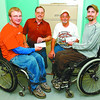 paraplegic donation in saturday dave milne sept 5 03 Bill Lindstrom, left rear, Cruisin Classics car club member and club president Allan Tofsrud present Paraplegic Association members Robert Hedges, left and Ryan Purves with bursary cheques for $250 each.