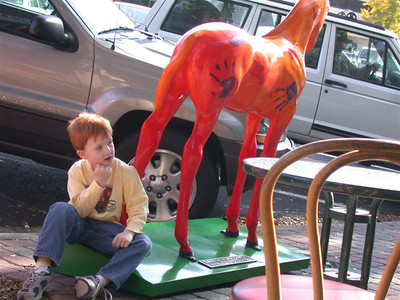 I thought the kid was cute sitting next to the painted horse