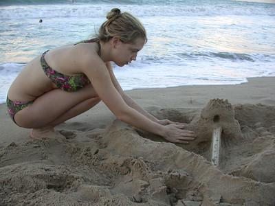 Meg works on the oceanside fort