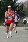 2003 Sooke River 10K - Bob Janicki better concentrate on the running through the finish!