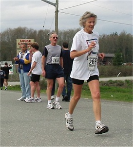 2003 Sooke River 10K - Marie Fisher, with husband Wayne in the background