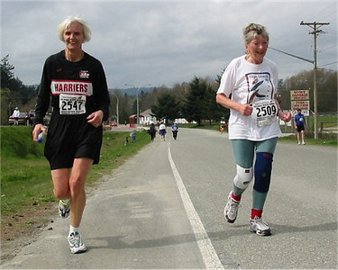 2003 Sooke River 10K - Sandy Anderson runs in with Jytte Haagensen