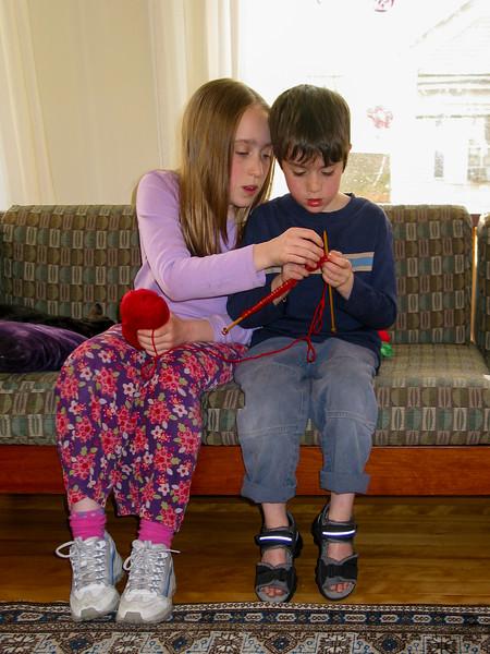 Isabel helping Benjamin with knitting