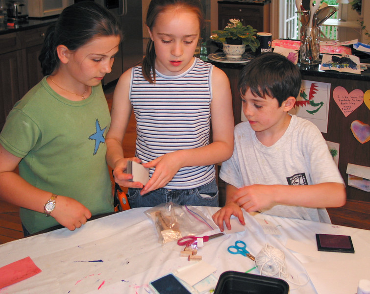 Megan, Isabel, and Benjamin working on some crafts