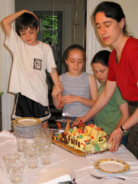 Chantal preparing to cut the cake