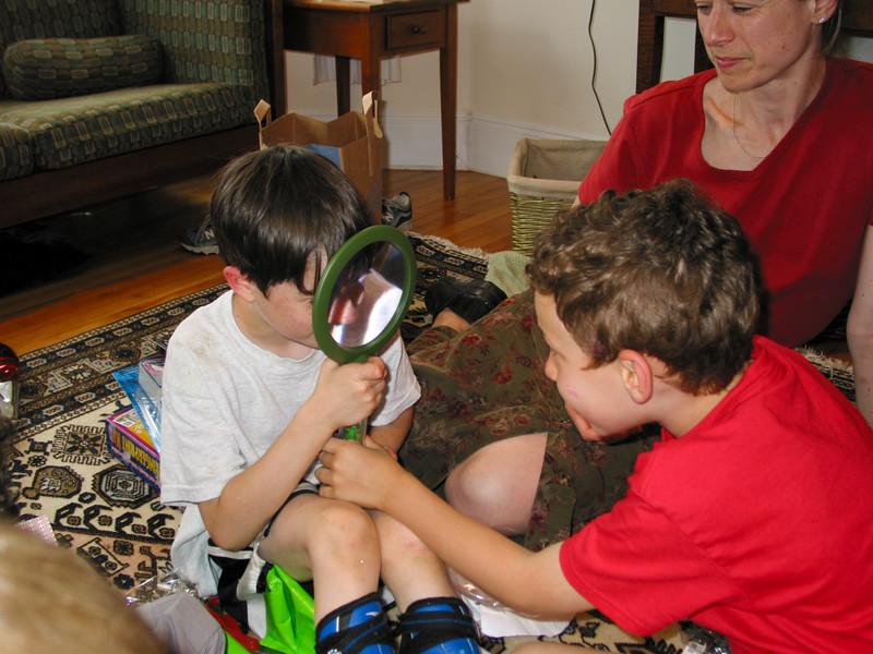Benjamin admiring presents: a magnifying glass