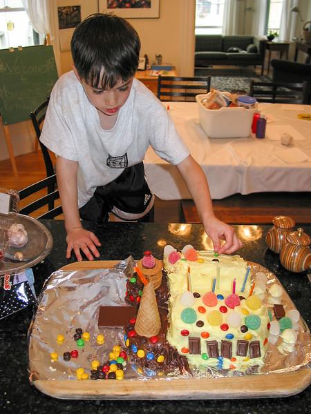 Benjamin decorating the castle cake