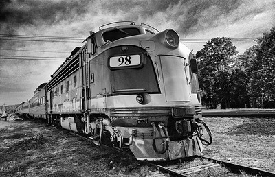 This train was on a siding in Branson.   It appears to be running from the approaching storm.   Diesel-electric locomotive, Branson, 2003