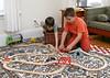 Benjamin and Benjamin F., playing with trains