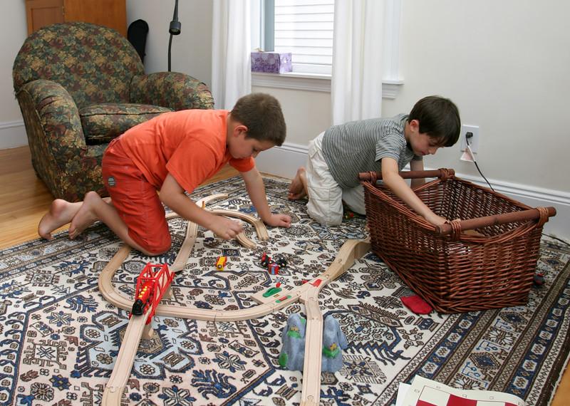 Benjamin F. and Benjamin, building a train layout
