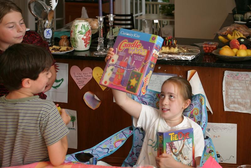 Isabel admiring birthday presents
