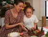Chantal cutting cake for Isabel