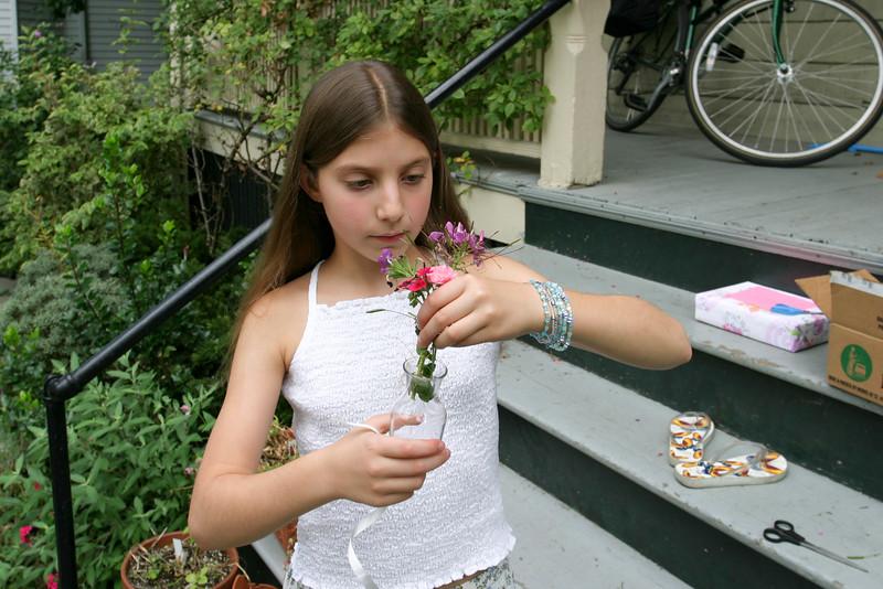 Isabelle F. making little flower vases