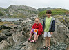 Isabel and Benjamin enjoying the rocks by the shore