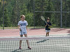 Isabel and Benjamin on the motel tennis court