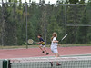 Benjamin and Isabel running for the tennis ball