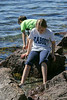 Benjamin and Isabel wading along the shore
