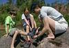 Benjamin, Isabel, and Chantal, getting socks back on