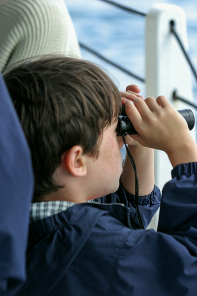 Benjamin looking through binoculars