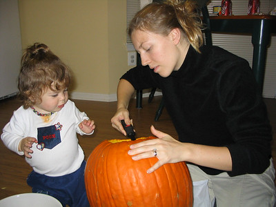 Oct. 29-31, 2003 photos  (Hailey makes her first Jack-O-Latern for Halloween. Then she dresses up as a butterfly and has her Young School parade and goes Trick or Treating.)