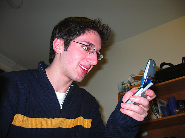 aaron_playing_with_meghs_fone.JPG