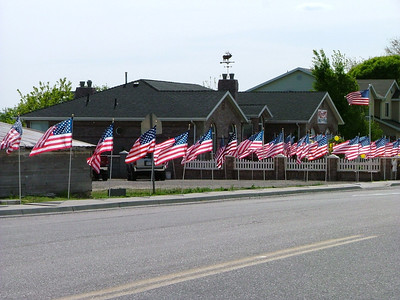 Flags in American Fork for a soldier's homecoming