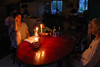 Chantal reading aloud by lamplight