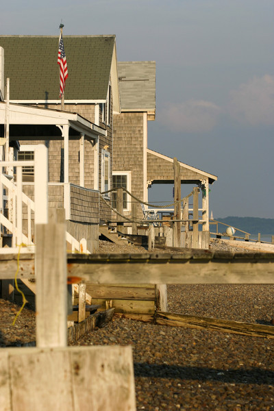 Front beach cottages glowing in the evening sun