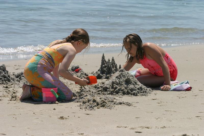 Isabel and Deanna bulld a sand castle