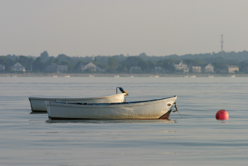 Boats moored off the front beach, Barnstable in the background