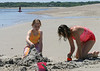 Isabel and Deanna bullding a sand castle
