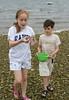 Isabel and Benjamin gathering shells