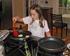 Isabel making pancakes