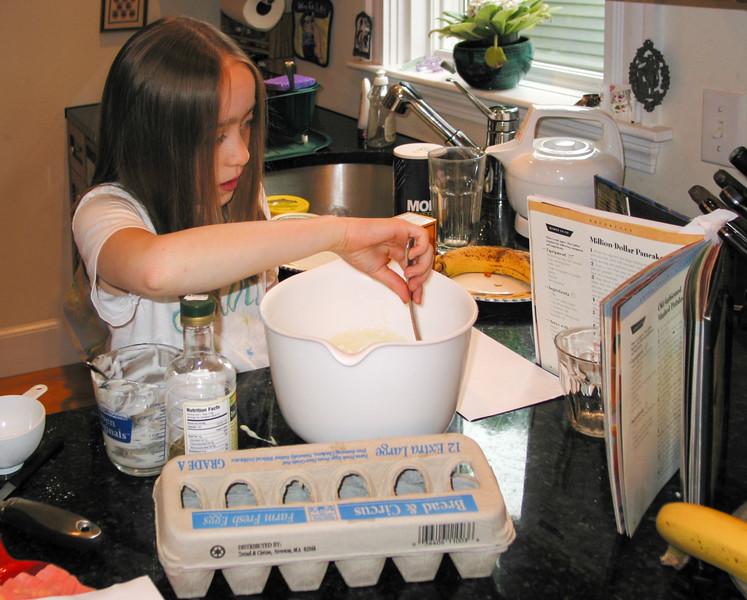 Isabel mixing pancake batter