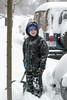 Benjamin shoveling snow