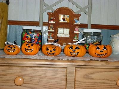 GrandPumpkins faces on rack