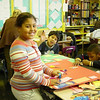 Deyzhane with her Project Muse art project, PS64<br /> Date: 11.09.2004<br /> From Shuttlefly, low res<br /> by: Flora Rodriguez, Archivist<br /> Location: V: Photos