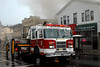 Passaic, NJ Tower Ladder 1 works the Main Ave. side of the fire.