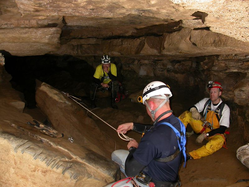 This caving trip took place in Oct. 2004.  We are in Ellison's Cave in LaFayette, GA.  It is home to two of the deepest free-fall pits in North America.  Fantastic Pit measures in at 586 feet deep, and Incredible Pit is 440 feet deep.  Our destination on this trip was Fantastic Pit, the deeper of the two.  In this photo, Dirty Dave and Brent are waiting while Nick rigs the 125 feet deep Warm-Up Pit.  This pit is one of the obstacles en route to Fantastic.  And of course I'm scurrying around with my camera gear!