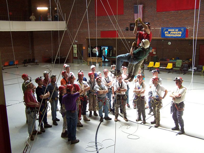 "If for some reason a climber has difficulty on rope [technical difficulty, injury from fallen rock, exhaustion, etc], it is imperative that someone QUICKLY get them off of the rope.  Sitting motionless in a harness can cause ""Harness Hang Syndrome"".  The climber eventually passes out, and as their body goes limp, it tips backward into a horizontal position with their abdomen (where the rope is attached to their harness) higher than their feet and head.  When this occurs, the climber will NOT regain consciousness and will die within minutes unless rescued.  So the students here are learning a ""fixed brake"" pick-off technique that allows them to assist a fellow climber to the bottom of the drop."