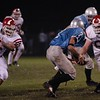 John Barrett (55) prepares to join James Lill in a sack against Willowbrook in the first game of the year.