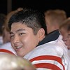 Kevin Ahn enjoys a moment of satisfaction as the Old Oaken Bucket is delivered to the Red Devils after the game.