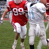 John Cima chases down the Willowbrook QB during Round One playoff action.