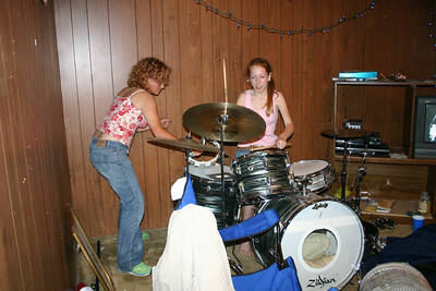 Jessie and Sarah give the neighbors a drum solo to equalize the noise levels