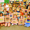 Highglen Earth Day2/Thursday Brent Braaten-April 21/2004  Students in 6-9 year old class at Highglen Elementary school show off their bags thay decorated. Jody Maher class made the bags on Tuesday with the help of student teacher Jennifer Markides. The bags will be used by Save-On Foods in Spruceland for groceries on Earth Day.