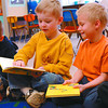 All About Me Book2/Tuesday Brent Braaten-April 5/2005  Kenneth Davis, 5, and Brodin Yensen, 6, look at their books received Monday morning. The 'My School Fun Book' is a personalized begining book giver to kindergarden children starting to read. The whole kindergarden class at Van Bien received books beacuse of the generous support of  realeastate agents at Re/Max and the school PAC. Pat Klassen at All about You coordinated the give-a-book program. About 160 students will receiv a book this year.